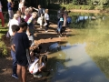 people at pond